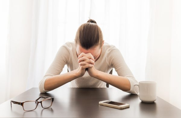Stressed woman in office setting